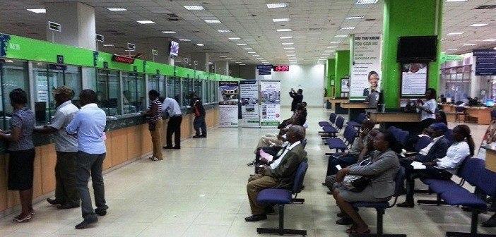Kenyans queuing to bank at a local bank: Kenya Commercial Bank