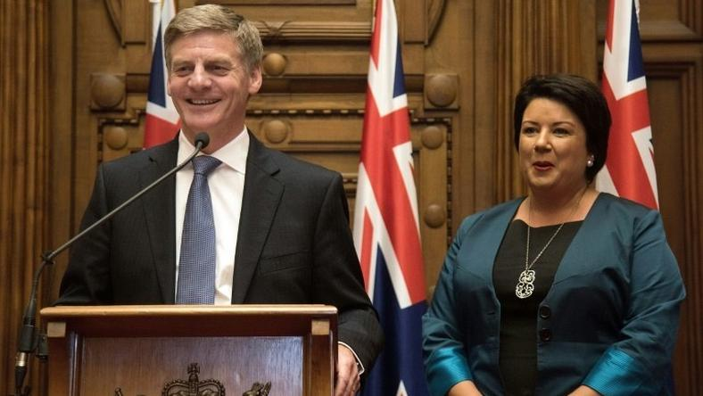 New Zealand's new Prime Minister Bill English (L) speaks to the media beside his deputy Paula Bennett during a press conference at Parliament in Wellington on December 12, 2016