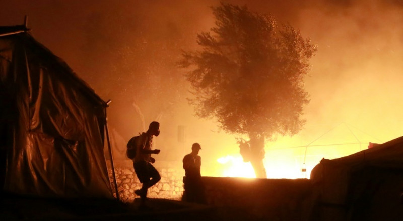 Five migrants arrested over Greek camp fire: minister