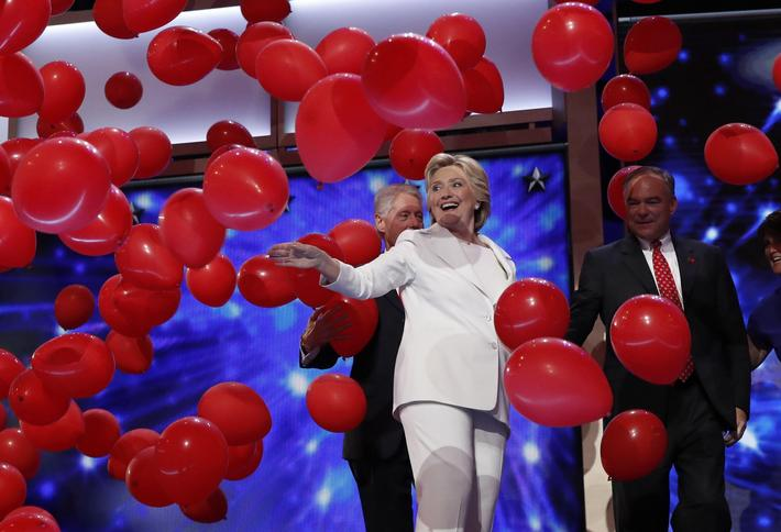 Democratic presidential nominee Hillary Clinton celebrates with her vice presidential running mate S