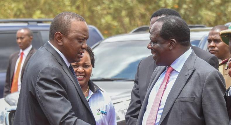 President Uhuru shakes hands with CoG Chair Wycliffe Oparanya when he arrived for the 2019 Devolution Conference in Kirinyaga County