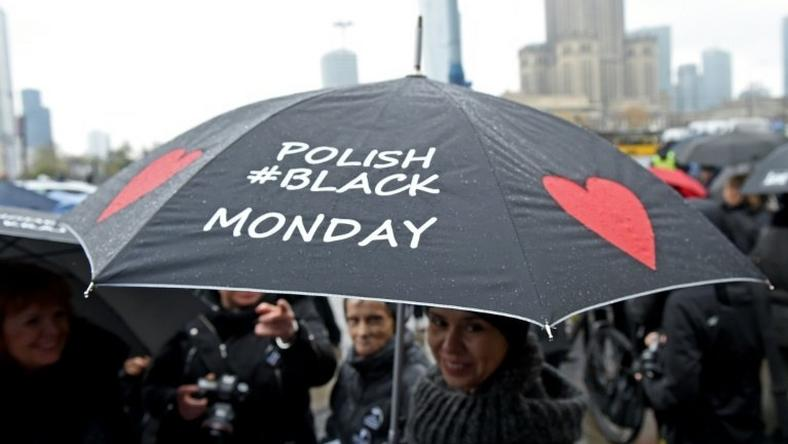 A woman raises her umbrella as a symbol of their protest, as thousands of women launched another round of protests against efforts to tighten Poland's abortion law on October 24, 2016