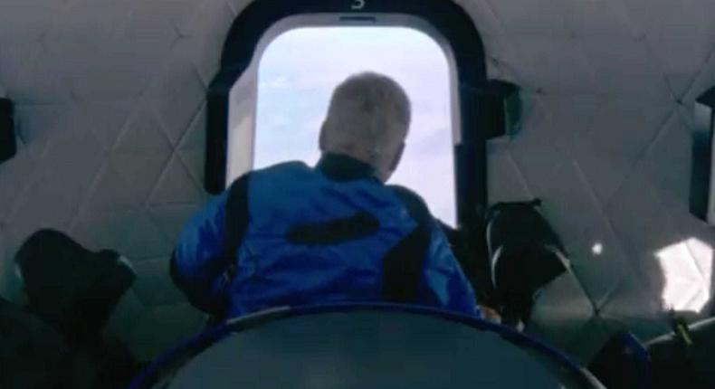 William Shatner gazes at Earth from the window of Blue Origin's New Shepard capsule, October 13, 2021.