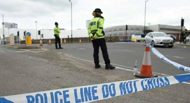 A police cordon surrounds Manchester Arena following a deadly terror attack