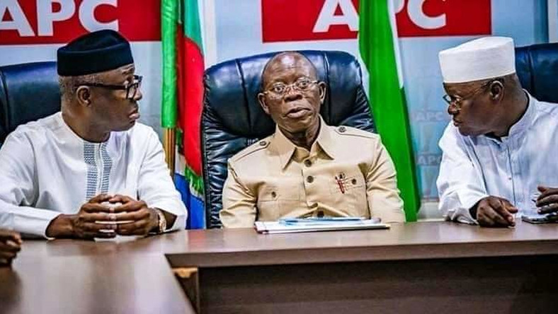 APC national chairman, Adams Oshiomhole in the middle (PM News)