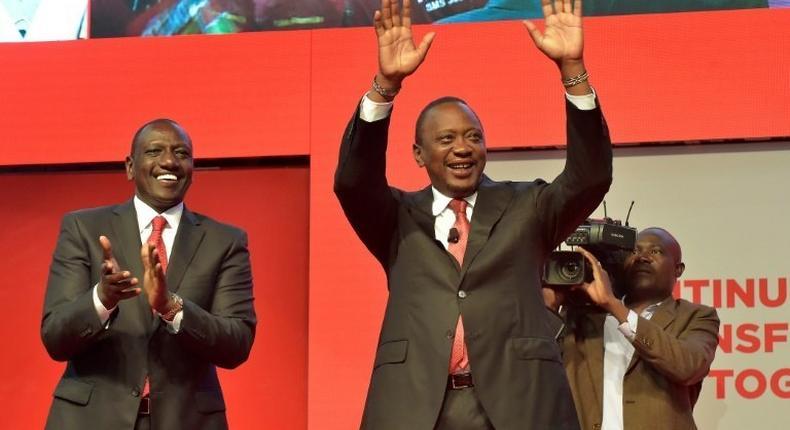 Deputy President William Ruto, left, with President Uhuru Kenyatta in June 2017