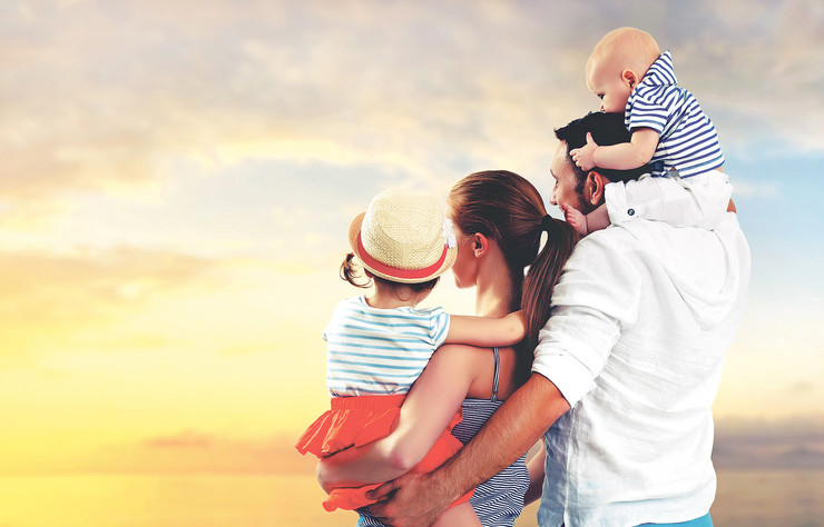 stock-photo-happy-family-of-father-mother-and-two-children-baby-son-and-daughter-on-the-beach-at-sunset-436882234