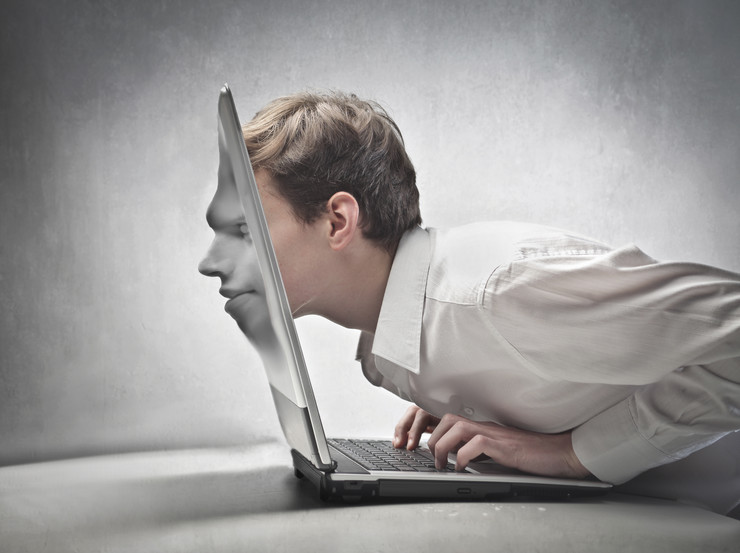 stock-photo-young-businessman-passing-his-head-through-a-laptop-screen-102766751