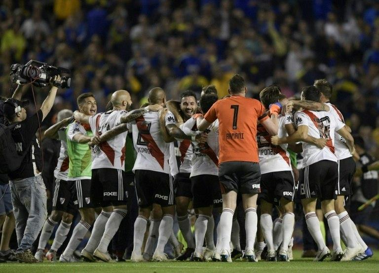 River Plate's players celebrate beating Boca Juniors 2-0 at the Bombonera in the Argentine Primera Division in September