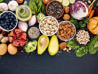 Ingredients for the healthy foods selection. The concept of healthy food set up on dark stone background.