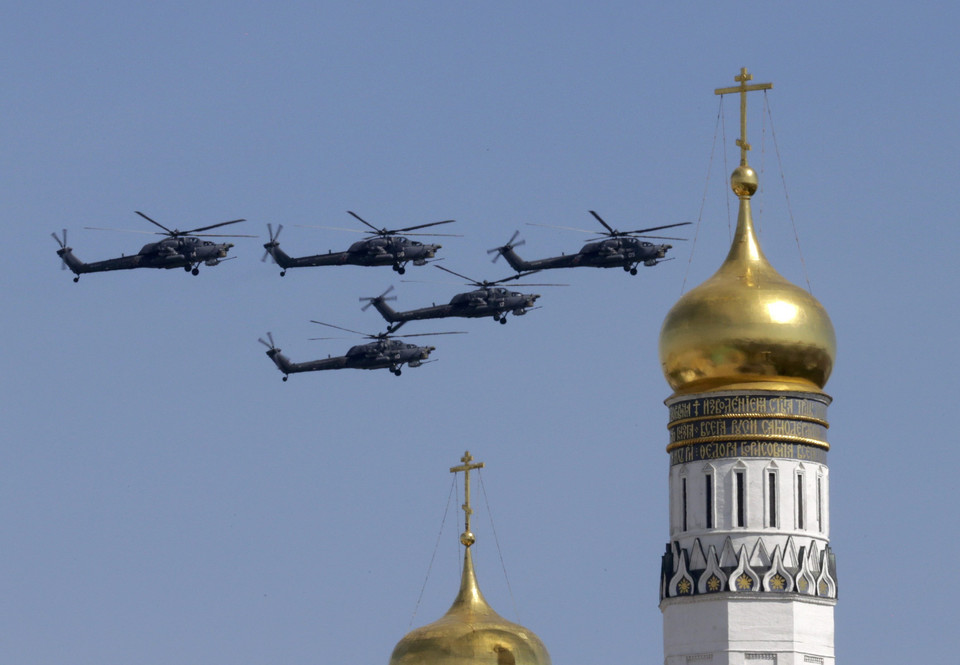 Mi-28 military helicopters fly in formation during the Victory Day parade above Red Square in Moscow