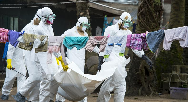 Medics carry the body of an Ebola victim during a past incident (Twitter)