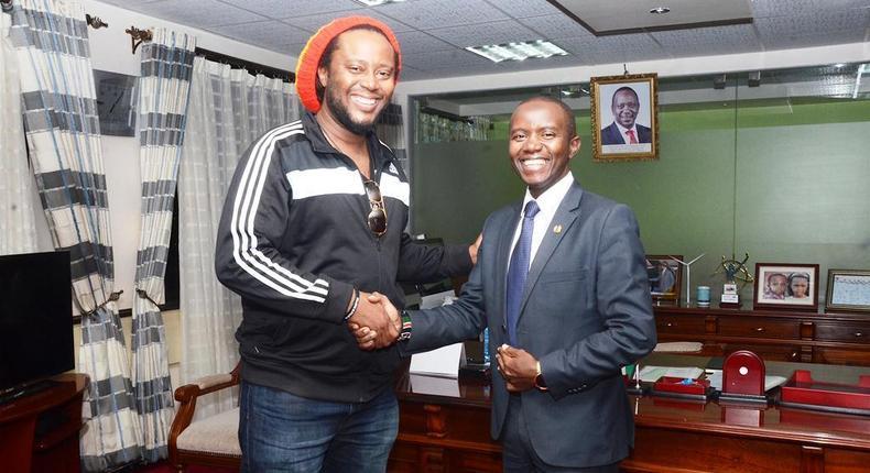 ICT Cabinet Secretary Joe Mucheru (right) with Jamaican Reggae star Duane Stephenson who paid him a courtesy call at his Teleposta Towers office, Nairobi.