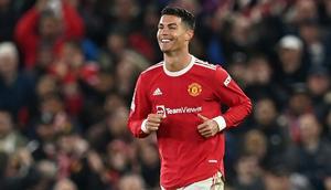 Cristiano Ronaldo celebrates after scoring Manchester United's winning goal against Atalanta Creator: Paul ELLIS