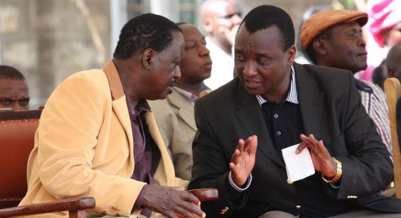 Nasa leader Raila Odinga (left) and lawyer Gitobu Imanyara consult during a past event.