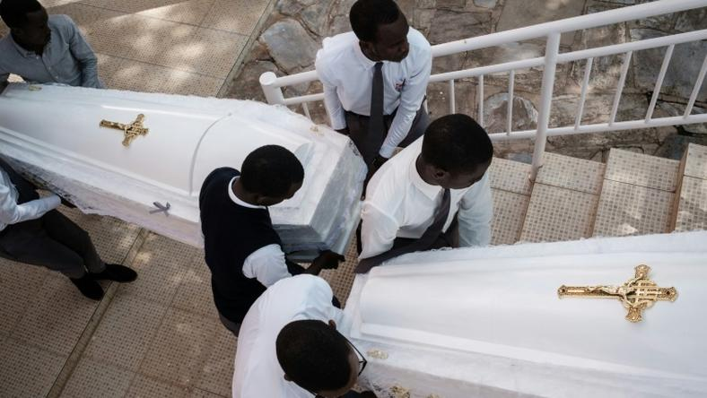 Eighty-one white coffins containing the remains of 84,437 victims of the 1994 mass killings were buried at the Nyanza Genocide Memorial in Kigali