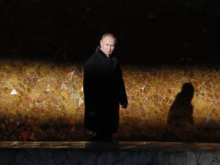 Russian President Putin attends a wreath laying ceremony at the eternal flame during an event to com