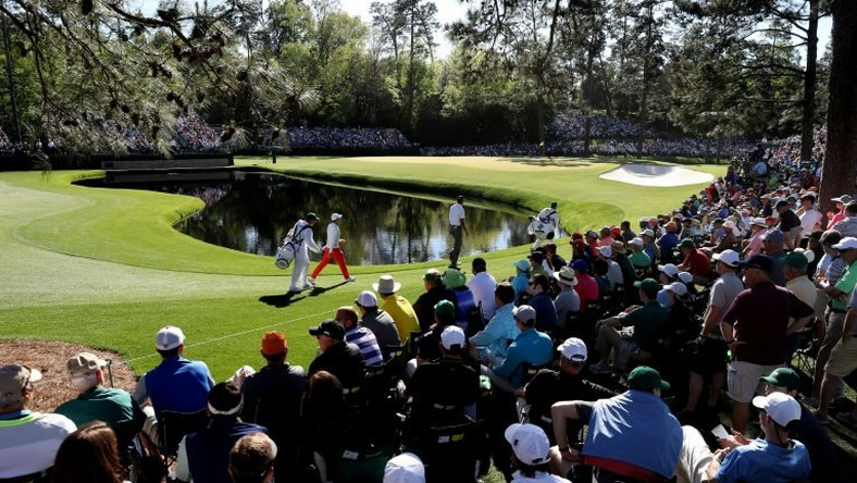 Rory McIlroy and Matt Kuchar walk to the 15th green during the third round of the 2017 Masters tournament, at Augusta National Golf Club in Georgia, on April 8