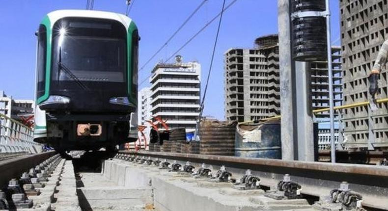 A labourer walks along a Metro-line construction in Ethiopia's capital Addis Ababa