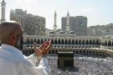 Meka, Ćaba, Supplicating_Pilgrim_at_Masjid_Al_Haram._Mecca