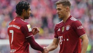 Bayern Munich midfielder Joshua Kimmich (R) and goal-scorer Serge Gnabry (L) during Saturday's league win Creator: Christof STACHE