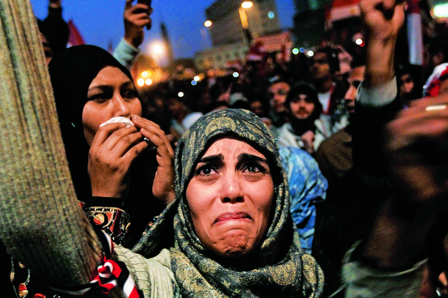 TURNING OF THE TIDE Above: a woman in Cairo's Tahrir Square in 2011 after President Hosni Mubarak said he would step down.