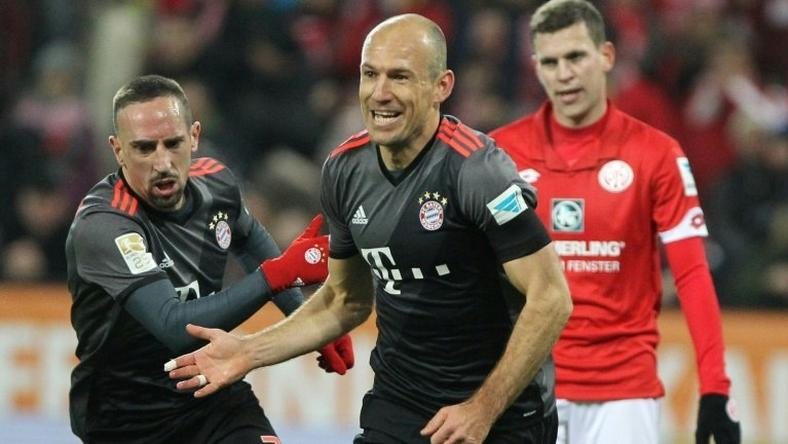 Bayern Munich's midfielder Arjen Robben celebrates scoring the 2-1 goal with Bayern Munich's midfielder Franck Ribery (L) during the German first division Bundesliga football match between FSV Mainz 05 and FC Bayern Munich December 2, 2016
