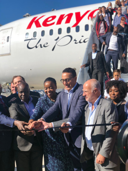 Kenya's Cabinet Secretary for Tourism & Wildlife, Hon. Najib Balala being assisted to cut the ribbon at Genève airport in Geneva Switzerland.