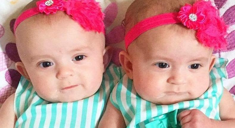 Ella (left) was discovered lying cold and lifeless in her cot with her twin sister, Lola (right), by her side