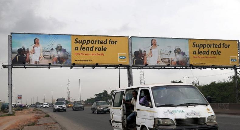A billboard advertising MTN telecommunication company is seen along a road in Lagos November 16, 2015. Nigeria is standing by a $5.2 billion fine imposed on MTN Group for failing to disconnect unregistered SIM cards though Monday's payment deadline may lapse while a company appeal is considered, Nigeria's telecoms regulator said.  REUTERS/Akintunde Akinleye