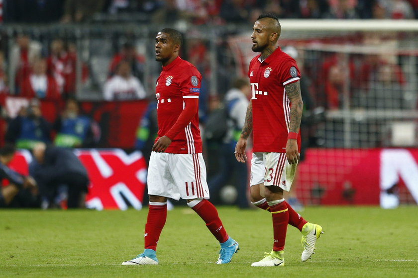Bayern Munich's Arturo Vidal looks dejected after being sent off as Real Madrid's Sergio Ramos looks
