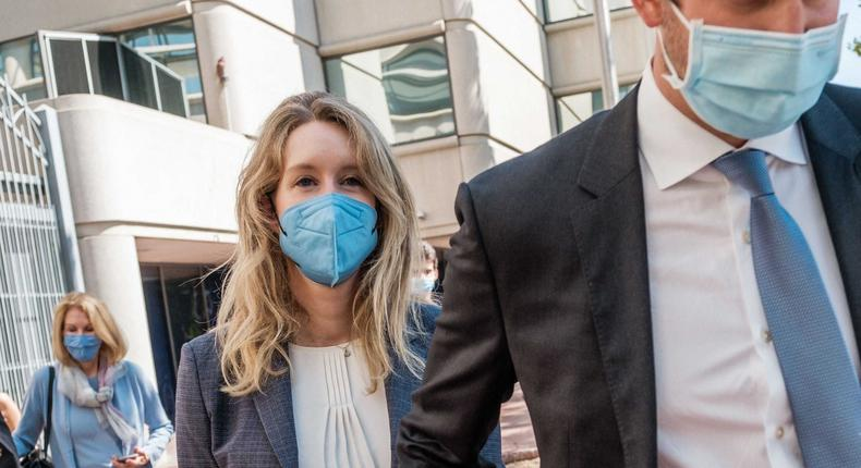 Elizabeth Holmes, founder and former CEO of blood testing and life sciences company Theranos, leaves the courthouse with her husband Billy Evans after the first day of her fraud trial in San Jose, California on September 8, 2021.