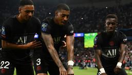 PSG players celebrate after Idrissa Gana Gueye (R) put them ahead against Montpellier Creator: FRANCK FIFE