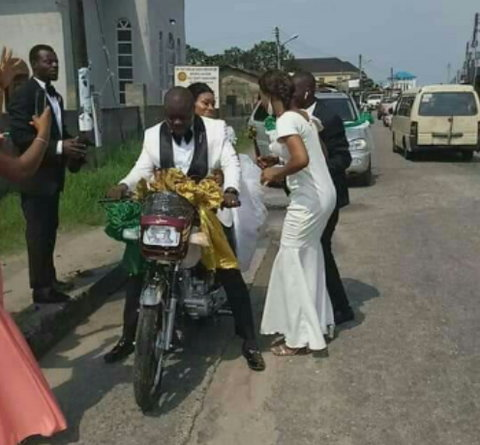 Newly weds spotted on a motorbike