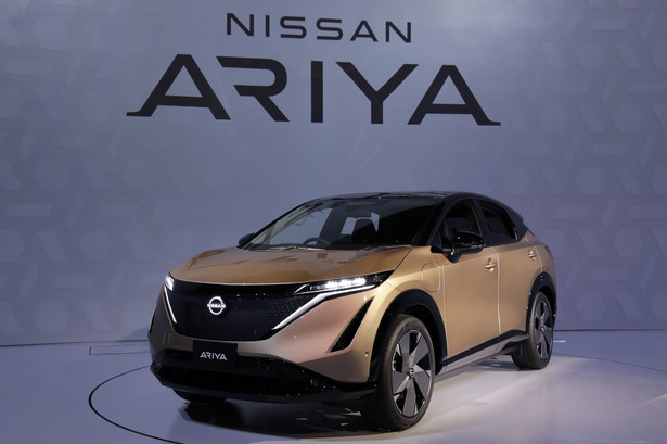"""A Nissan Motor Co. Ariya electric crossover sport utility vehicle (SUV) stands on display during a media preview at Nissan Pavilion Yokohama in Yokohama, Japan, on Tuesday, July 14, 2020. Nissan unveiled a new electric vehicle and redesign of its """"hamburger"""" corporate logo, seeking to make a fresh start after months of management turmoil and declining profitability. Photographer: Kiyoshi Ota/Bloomberg"""