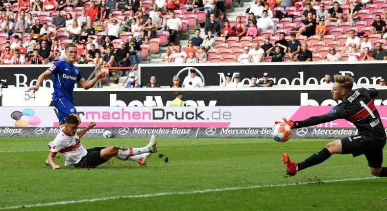 Florian Wirtz (L) scores the deciding goal to seal Leverkusen's 3-1 win at Stuttgart on Sunday Creator: THOMAS KIENZLE
