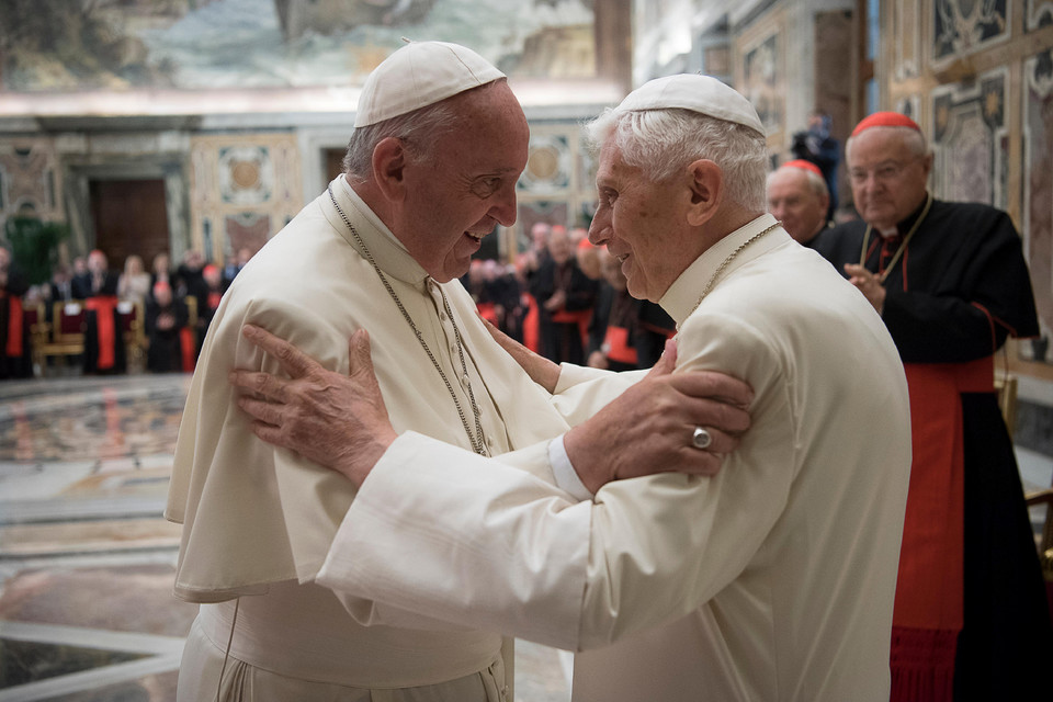 Former pope Benedict is greeted by Pope Francis during a ceremony to mark his 65th anniversary of ordination to the priesthood at the Vatican