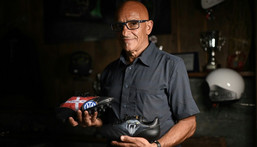 Italian artist Salvatore Cosentino poses with a pair of boots he designed as a tribute to Christian Eriksen Creator: Marco BERTORELLO