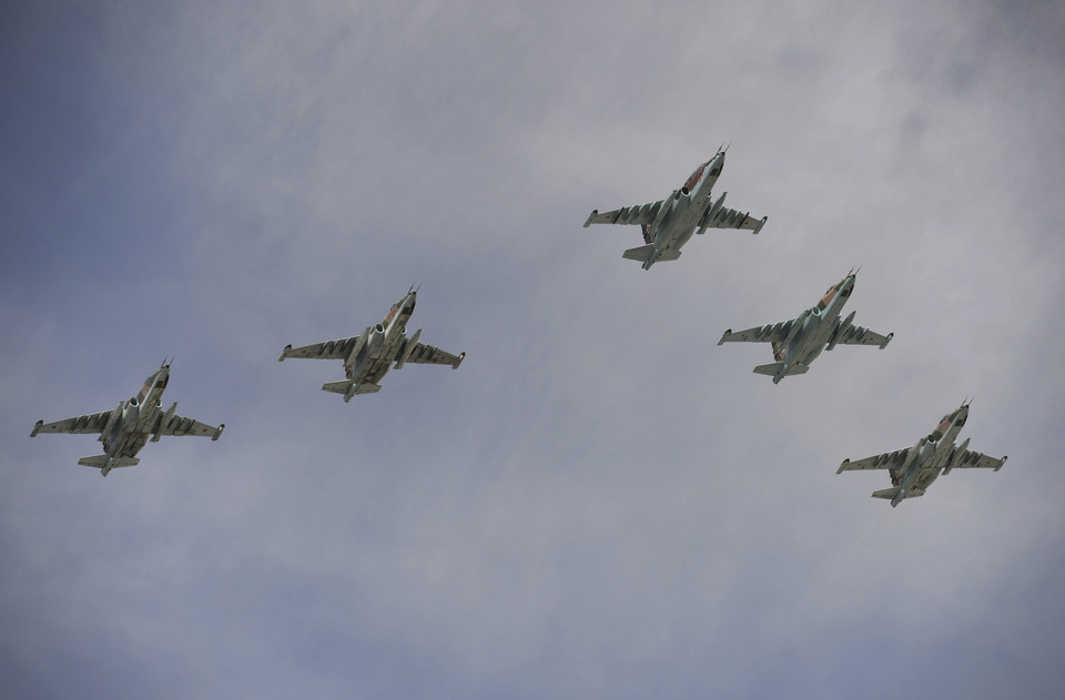 Sukhoi Su-25SM Frogfoot ground-attack planes fly in formation over the Red Square during the Victory Day parade in Moscow