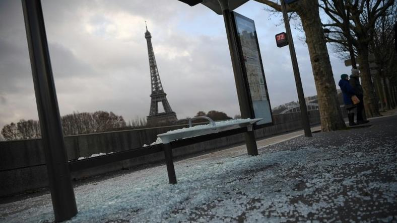 Cleaners swept up broken glass from smashed shop windows and bus stops across Paris on Sunday