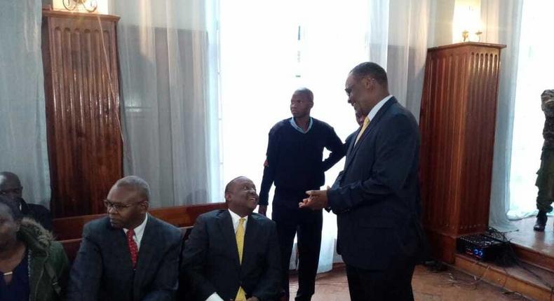 Former Nairobi Governor Evans Kidero consoles Treasury CS Henry Rotich