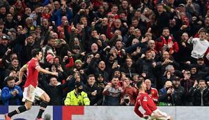 Cristiano Ronaldo (right) scored a late Manchester United winner for the second consecutive Champions League game Creator: Paul ELLIS