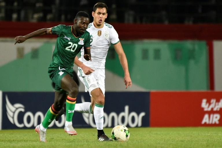 Aissa Mandi (R) of Algeria chases Evans Kangwa of Zambia during an Africa Cup of Nations qualifying match in Blida Thursday, which the home team won 5-0