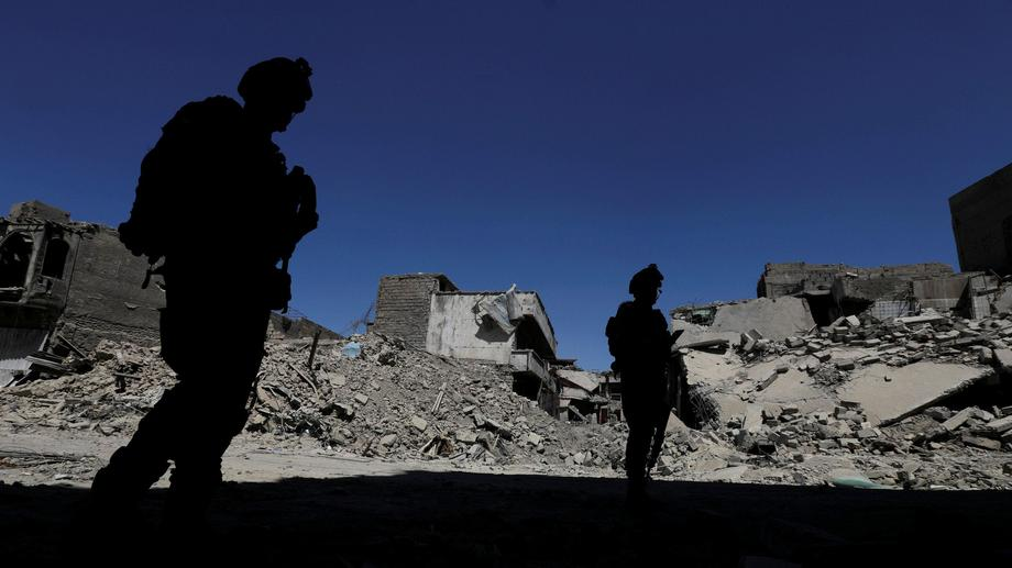 Members of Iraqi federal police patrol in the destroyed Old City of Mosul