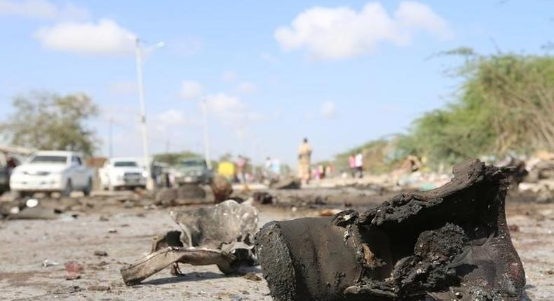A military boot is seen at the scene of a suicide car bomb attack by al Shabaab in Somalia's capital Mogadishu, Somalia, September 18, 2016. REUTERS/Feisal Omar