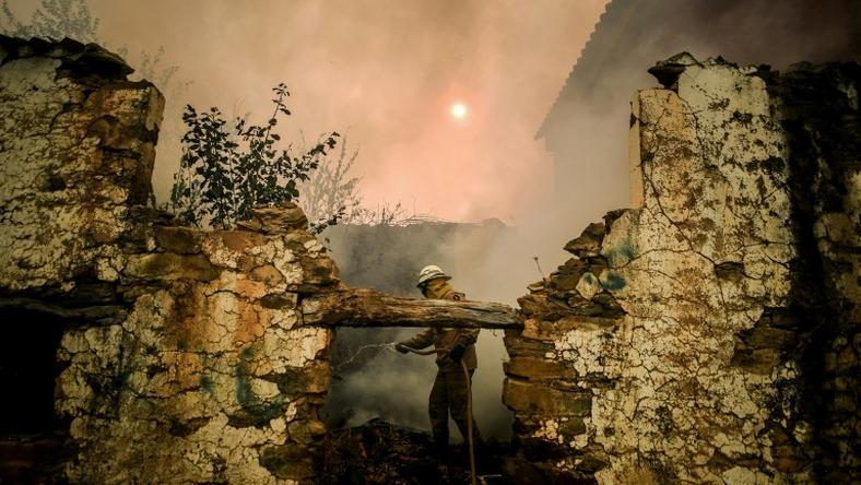 A National Guard firefighter helps battle a wildfire in the village of Roda in central Portugal on July 21