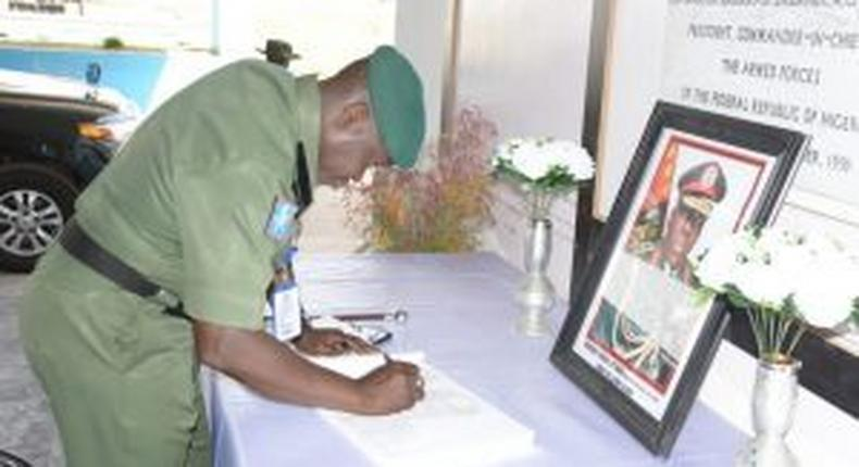 The GOC 1 Division Nigerian Army,Kaduna , signing condolence register of Late COAS Lt-Gen Ibrahim Attahiru other officers involved in plane crash on May 21 in Kaduna. [NAN]