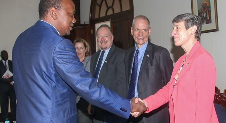 President Uhuru Kenyatta with fomer U.S. Ambassador to Kenya Robert Godec