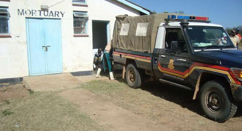 Police van outside a Mortuary