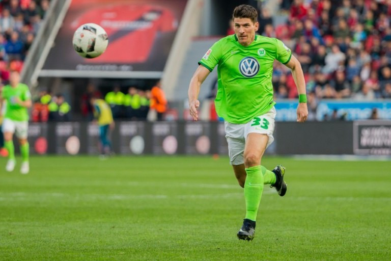 Wolfsburg's forward Mario Gomez runs with the ball against Bayer Leverkusen on April 2, 2017
